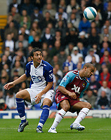 Photo: Steve Bond.<br />Birmingham City v West Ham United. The FA Barclays Premiership. 18/08/2007.  Keiron Dyer (R) turns defender Stephen Kelly (L)
