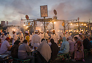 Food stall in Djemaa El Fna Square, in the medina, Marrakesh, at dusk. The square is a Unesco World Heritage site.