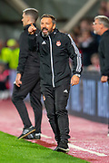 Aberdeen manager Derek McInnes shouts at his players during the Betfred Scottish Football League Cup quarter final match between Heart of Midlothian FC and Aberdeen FC at Tynecastle Stadium, Edinburgh, Scotland on 25 September 2019.