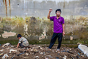 Abah Dayat rests after collecting scraps on the Citarum River.  Citeureup Village, Kabupaten Bandung.  ..Credit: Andri Tambunan for Greenpeace