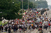 A protest march led by Michael Brown Sr. walks the streets to mark the one year anniversary of the killing of son Michael Brown Jr. in Ferguson, Missouri August 9, 2015.  Several hundred people gathered in Ferguson, Missouri, on Sunday to mark the one-year anniversary of the shooting death of an unarmed black teenager by a white police officer that sparked protests and a national debate on race and justice.  REUTERS/Rick Wilking