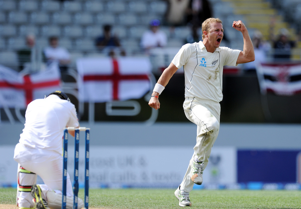 New Zealand's Neil Wagner, right, celebrates after taking the wicket of a kneeling England's Ian Bell for 75 on the fifth day of the 3rd international cricket test, Eden Park, Auckland, New Zealand, Tuesday, March 26, 2013. Credit:SNPA / Ross Setford