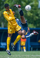 Irvine Valley College's Francisco Hernandez tries to kick the ball in the goal around Kyle Woodson of Yavapai College during Thursday's game.