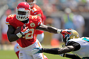 Kansas City Chiefs running back Cyrus Gray (32) stiff arms Jacksonville Jaguars outside linebacker Geno Hayes (55) as he runs upfield during the Chiefs 28-2 win at EverBank Field on Sept. 8, 2013 in Jacksonville, Florida. The <br /> <br /> ©2013 Scott A. Miller