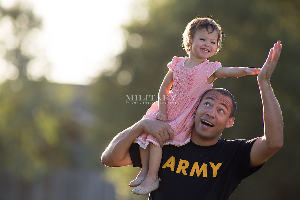 Cole, MR for self and daughter, at park, sunset portraits.  Stock photograph by Hans Halberstadt.  Reproduction requires written permission from Hans Halberstadt, Military Stock Photography, or designated representative