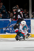 KELOWNA, CANADA - FEBRUARY 18: Calvin Thurkauf #27 of the Kelowna Rockets gets tangled up with Sam Ruopp #2 of the Prince George Cougars during first period on February 18, 2017 at Prospera Place in Kelowna, British Columbia, Canada.  (Photo by Marissa Baecker/Shoot the Breeze)  *** Local Caption ***