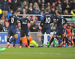 Manchester United's Robin van Persiece celebrates with teams mates. - Photo mandatory by-line: Alex James/JMP - Tel: Mobile: 07966 386802 01/02/2014 - SPORT - FOOTBALL - Britannia Stadium - Stoke-On-Trent - Stoke v Manchester United - Barclays Premier League