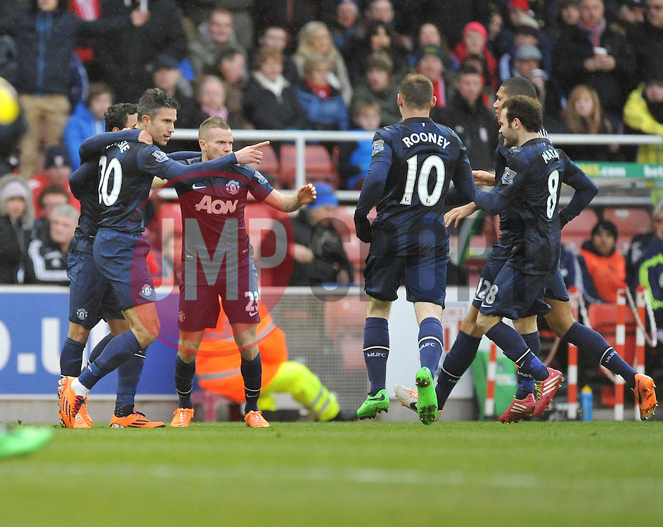 Manchester United's Robin van Persiece celebrates with teams mates. - Photo mandatory by-line: Alex James/JMP - Tel: Mobile: 07966 386802 01/02/2014 - SPORT - FOOTBALL - Britannia Stadium - Stoke-On-Trent - Stoke v Manchester United - Barclays Premier League