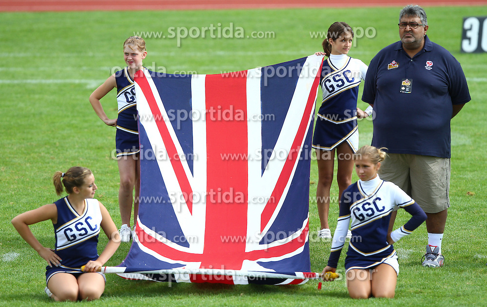 27.07.2010, Wetzlar Stadion, Wetzlar, GER, Football EM 2010, Team France vs Team Great Britain, im Bild Tariq Ayub, (Team Great Britain, Headcoach) neben Cheerleader mit englischer Fahne,  EXPA Pictures © 2010, PhotoCredit: EXPA/ T. Haumer / SPORTIDA PHOTO AGENCY