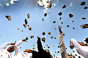 Graduating midshipmen toss their covers skyward as commencement concludes at the United States Naval Academy in Annapolis, Md., May 23, 2014. DoD Photo by Glenn Fawcett (Released)