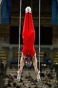 16 August 2004: Romanian Gymnast RAZVAN DORIN SELARIU (ROM) competing in the rings event during the Men's Artistic Gymnastics Team Final in the Olympic Indoor Hall at the 2004 Olympic Games, Athens, Greece. <br />