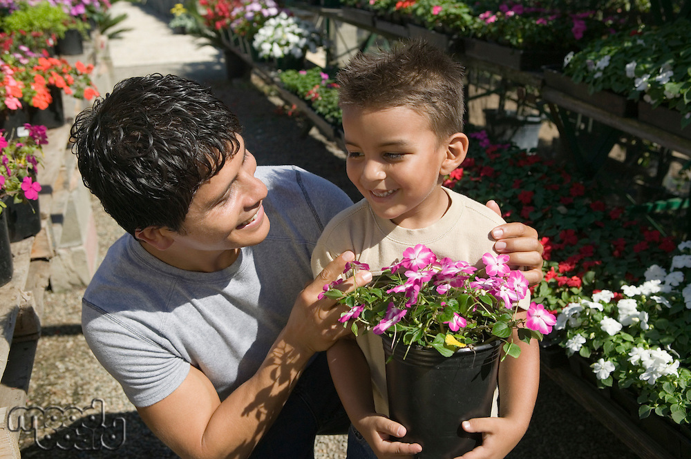 Father and Son Shopping for Plants
