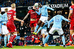 Aden Flint and Nathan Baker of Bristol City are challenged by Yaya Toure of Manchester City - Rogan/JMP - 09/01/2018 - Etihad Stadium - Manchester, England - Manchester City v Bristol City - Carabao Cup Semi Final First Leg.