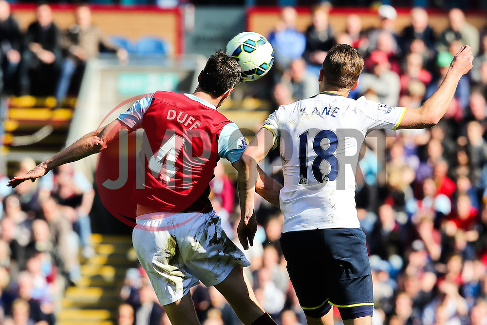 Tottenham Hotspur Captain Harry Kane challenges Burnley's Michael Duff   - Photo mandatory by-line: Matt McNulty/JMP - Mobile: 07966 386802 - 05/04/2015 - SPORT - Football - Burnley - Turf Moor - Burnley v Tottenham Hotspur - Barclays Premier League