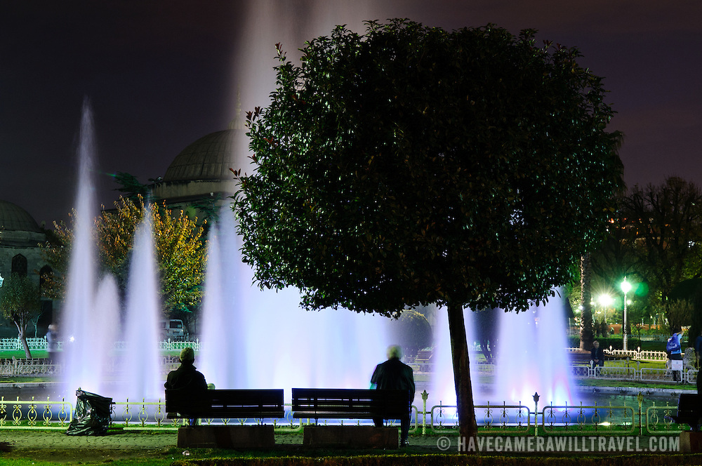 A lighted fountain in Sultanahment Park at night. Sultan Ahmed Mosque (Turkish: Sultanahmet Camii) known popularly as the Blue Mosque is a Muslim (Sunni) Mosque in the center of Istanbul's old town district of Sultanahmet. It was commissioned by Sultan Ahmed I and completed in 1616,