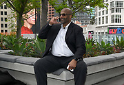 Winston Moss talks on a cell phone after being introduced as coach and general manager of the XFL team in Los Angeles during a news conference, Tuesday, May 7, 2019, in Los Angeles. Play will begin in the eight-team league on Feb. 8-9, 2020 with teams in Dallas, Houston, Los Angeles, New York, St. Louis, Seattle , Tampa Bay and Washington D.C.