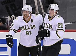 Oct 8; Newark, NJ, USA; Dallas Stars center Brad Richards (91) and Dallas Stars left wing Loui Eriksson (21) celebrate Eriksson's game winning goal during overtime at the Prudential Center. The Stars defeated the Devils 4-3 in overtime.