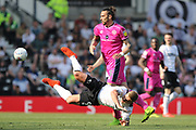 QPR defender Geoff Cameron brings down Derby County forward Martyn Waghorn during the EFL Sky Bet Championship match between Derby County and Queens Park Rangers at the Pride Park, Derby, England on 22 April 2019.