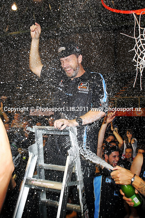 Breakers' Head Coach Andrej Lemanis gets the champagne treatment from the team. iinet ANBL, Grand Final Game 3, New Zealand Breakers vs Cairns Taipans, North Shore Events Centre, Auckland, New Zealand. Friday 29th April 2011. Photo: Anthony Au-Yeung / photosport.co.nz