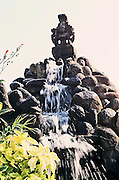 Idol of Hindu Goddess atop a waterfall in the garden of Park guest house of Aurobindo Ashram,Pondicherry,India.