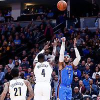 09 November 2017: Oklahoma City Thunder forward Carmelo Anthony (7) takes a jump shot over Denver Nuggets forward Paul Millsap (4) during the Denver Nuggets 102-94 victory over the Oklahoma City Thunder, at the Pepsi Center, Denver, Colorado, USA.