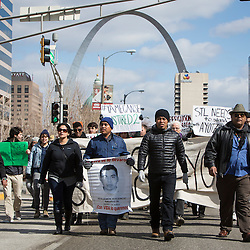 FRIDAY, MARCH 26, 2015 - Supporters of 43 students who disappeared in September 2014 from the Raúl Isidro Burgos Rural Teachers' College of Ayotzinapa in Iguala, Guerrero, Mexico, marched Friday through downtown St. Louis. Some in the group are making their way across the United States to spread their message that the Mexican government is ignoring their demands for justice, transparency and accountability. ©Photo by Jerry Naunheim Jr.