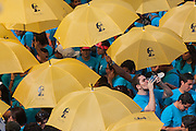 A hot pilgrim takes a drink of water standing in a sea of yellow umbrellas bearing the image of the Martyr Archbishop Oscar Romero.El Salvador celebrated Romero's beatification ceremony and mass . The Archbishop was slain at the alter of his Church of the Divine Providence by a right wing gunman in 1980. Oscar Arnulfo Romero y Galdamez became the fourth Archbishop of San Salvador, succeeding Luis Chavez, and spoke out against poverty, social injustice, assassinations and torture. Romero was assassinated while offering Mass on March 24, 1980.