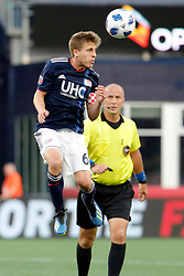 May 30, 2018 - Foxborough, MA, U.S. - FOXBOROUGH, MA - MAY 30: New England Revolution midfielder Scott Caldwell (6) heads the ball away during a match between the New England Revolution and Atlanta United FC on May 30, 2018, at Gillette Stadium in Foxborough, Massachusetts. The Revolution and Atlanta played to a 1-1 draw. (Photo by Fred Kfoury III/Icon Sportswire) (Credit Image: © Fred Kfoury Iii/Icon SMI via ZUMA Press)
