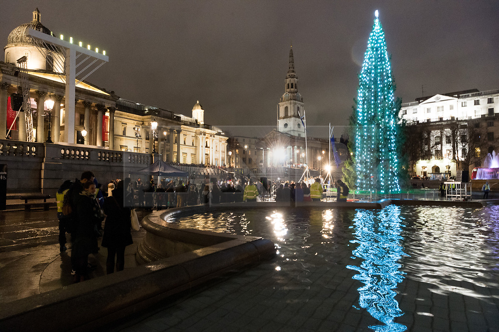 © Licensed to London News Pictures. 06/12/2018. London, UK. Visitors view the Trafalgar Square Christmas tree lighting. Every year, since 1947, the people of Norway have given the people of London a Christmas tree. This gift is in gratitude for Britain's support for Norway during World War I credit: Ray Tang/LNP