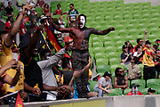 A PNG fan stands on the fence after a try was disallowed during the Rugby League World Cup Quarter-Final match between England and  Papua New Guinea at Melbourne Rectangular Stadium, Melbourne, Australia on 19 November 2017. Photo by Mark  Witte.