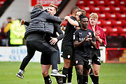 Barnsley manager Daniel Stendel celebrates with Barnsley defender Liam Lindsay (6) after the EFL Sky Bet League 1 match between Walsall and Barnsley at the Banks's Stadium, Walsall, England on 23 March 2019.