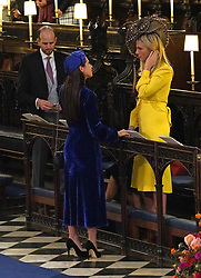 Wedding guests takes their seats ahead of the wedding of Princess Eugenie to Jack Brooksbank at St George's Chapel in Windsor Castle.