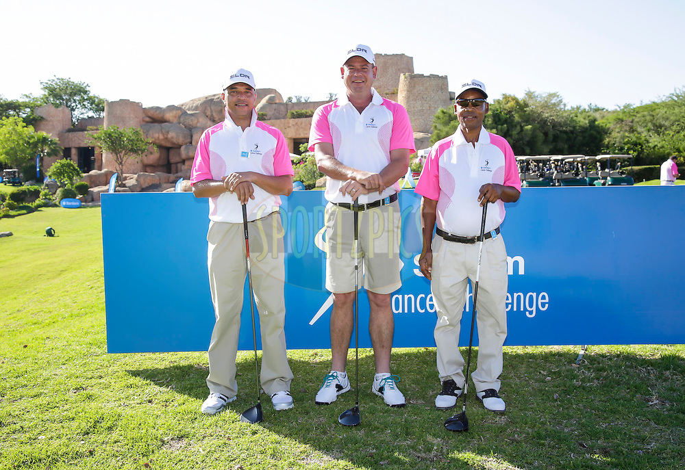 Evan de Kock, Dirk Odendaal and Thomas Mnguni during round one of the Sanlam Cancer Challenge Finals 2014 held at the Lost City Golf Course in Sun City near Johannesburg, South Africa on the 19th October 2014<br /> <br /> Photo by:  Dominic Barnardt/ SPORTZPICS