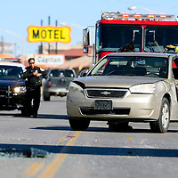 100313  Adron Gardner/Independent<br /> <br /> A Gallup firefighter places keys on the roof of a car involved in an accident on Historic Highway 66 near Ford Drive in Gallup Thursday. The accident closed off a block of eastbound traffic temporarily.  A second accident on Aztec and 4th Street occurred at nearly the same time.