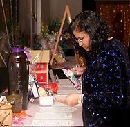 Sonia Morales, from Cincinnati examines items in the silent auction at the 17th Artemis Center Gala, Saturday night.