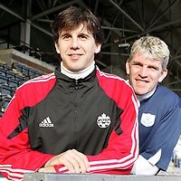 Former St Johnstone star Nick Dasovic pictured at McDiarmid Park with Jim Weir.  Nick now coaching with the Canadian national football team is staying with his old friend Jim Weir for a few days joining in with St Johnstone training before watching the Dundee v St Johnstone game on Saturday where he will meet up with a few more former St Johnstone pals in Alan Kernaghan and Billy Kirkwood, before heading back to Vancouver early next week.<br />Picture by Graeme Hart.<br />Copyright Perthshire Picture Agency<br />Tel: 01738 623350  Mobile: 07990 594431