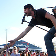 Grammy nominated country music star Dierks Bentley performs in the fan zone prior to the NCAA  Capital One Bowl football game between the Georgia Bulldogs and the Nebraska Cornhuskers, at the Florida Citrus Bowl on Tuesday, January 1, 2013 in Orlando, Florida. (AP Photo/Alex Menendez)
