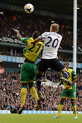 Norwich's Alexander Tettey and Tottenham's Michael Dawson  compete for the ball  - Photo mandatory by-line: Mitchell Gunn/JMP - Tel: Mobile: 07966 386802 14/09/2013 - SPORT - FOOTBALL -  White Hart Lane - London - Tottenham Hotspur v Norwich - Barclays Premier League