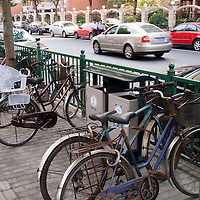 Shanghai, China bicycles parked alongside a street now populated with cars.