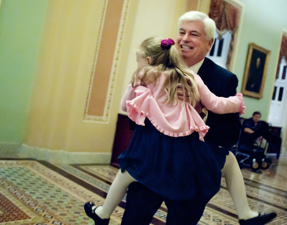 Nov 30, 2010 - Washington, District of Columbia, U.S. - Retiring Senator CHRIS DODD (D-CT) picks up his daugher Christina after delivering his final speech on the Senate floor thanking colleagues, supporters and friends. (Credit Image: © Pete Marovich/ZUMA Press)