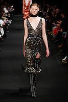 A model walks the runway wearing Altuzarra Fall 2015 during Mercedes-Benz Fashion Week in New York on February 14, 2015