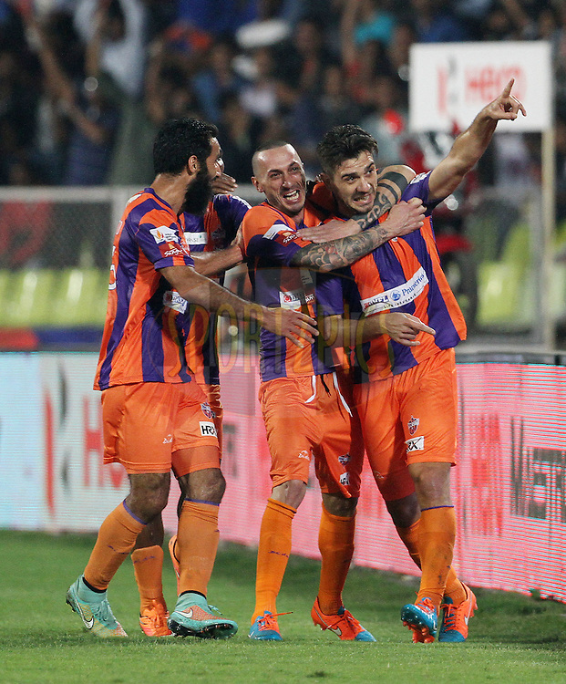 Kostas Katsouranis of FC Pune City celebrates a goal during match 44 of the Hero Indian Super League between FC Pune City and Atletico de Kolkata FC held at the Shree Shiv Chhatrapati Sports Complex Stadium, Pune, India on the 29th November 2014.<br /> <br /> Photo by:  Vipin Pawar/ ISL/ SPORTZPICS