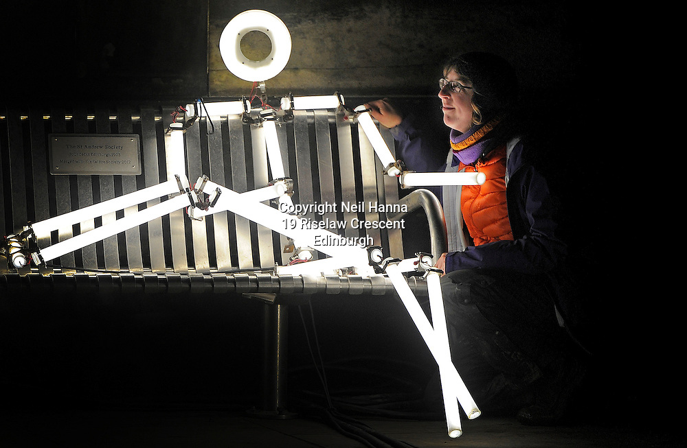 JP License<br /> From today 4th February until the 28th March 2016, St Andrew Square Garden will be taken over by illuminated stick men as part of this year&rsquo;s amazing light installation KEYFRAMES.<br /> <br /> Pic caption:  Production manager Hannah Ayre meets one of the stickmen on a park bench<br /> <br /> Created by French artists collective Groupe LAPS, KEYFRAMES uses LED lights tubes to create multiple static stick figures that, when paired with a soundtrack, flash on and off in a choreographed display to imitate movement.<br /> <br /> KEYFRAMES has previously exhibited in Singapore, Jerusalem, France, Spain and the Netherlands, and debuted in the UK in Durham at the 2013 Lumiere Festival. The free exhibition in St Andrew Square marks KEYFRAMES Scotland debut and will give the public the opportunity to experience the architecture and environment of St Andrew Square in a different light.<br /> The 80 light sculptures  take over St Andrew Square Garden  illuminated in sequence to an original musical composition. They are installed around the square to create an immersive environment and will allow the public to wander through the space.<br /> <br /> <br />  Neil Hanna Photography<br /> www.neilhannaphotography.co.uk<br /> 07702 246823