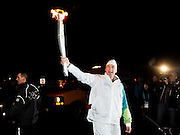 Gold medal winning Olympic athlete Matthew Pinsent during his Olympic torch run.  February 5th, 2010.  Whistler BC, Canada..David Buzzard/From the Canadian Press