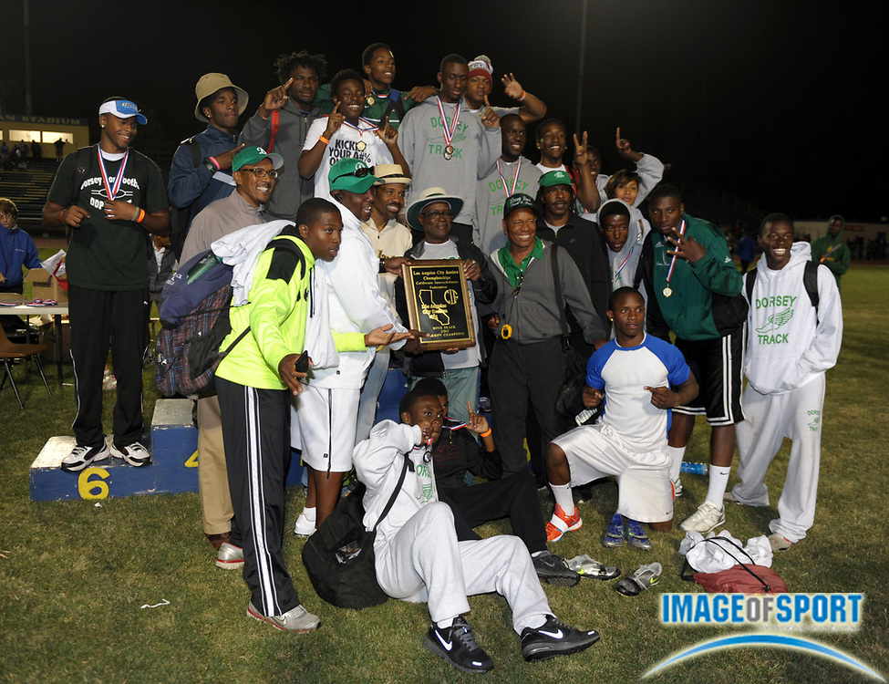 May 23, 2012; Lake Balboa, CA, USA; Members of the Dorsey boys team pose with the championship plaque after winning the team title in the 2012 CIF Los Angeles Section championships at Birmingham High.