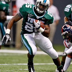 Sep 11, 2010; New Orleans, LA, USA; Tulane Green Wave running back Albert Williams (25) runs with the ball during a game against the Mississippi Rebels at the Louisiana Superdome. The Mississippi Rebels defeated the Tulane Green Wave 27-13.  Mandatory Credit: Derick E. Hingle