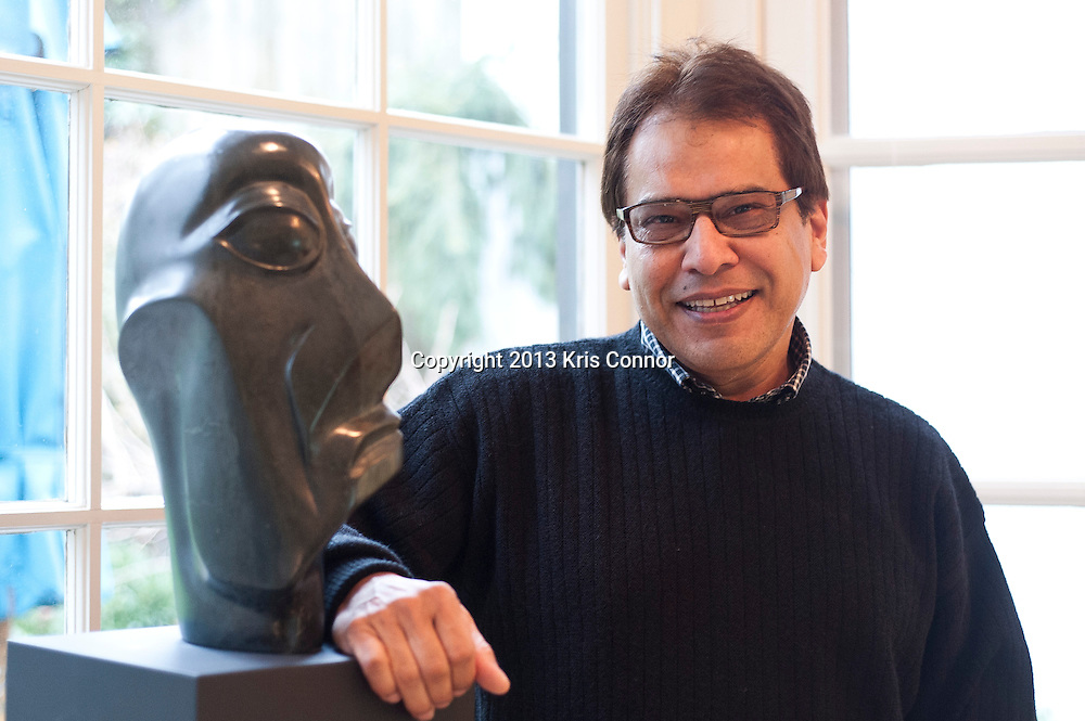Mario Castillo of The Aegis Group poses for a portrait in front of  his ?Rainmaker? sculpture at his home in northwest Washington D.C. on January 11, 2013. Photo by Kris Connor