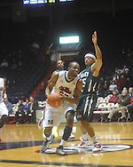 """Ole Miss guard Zach Graham (32)  drives past Mississippi Valley State's Kevin Burwell (25) at C.M. """"Tad"""" Smith Coliseum in Oxford, Miss. on Monday, December 13, 2010."""