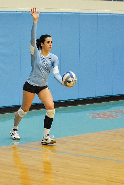 10/18/2013 - Cousens Gym, Tufts Medford campus - Tufts sophomore, Kyra Baum, setter and defensive specialist, serves the ball during the volleyball home game where Tufts defeats Hamilton 25-12. Caroline Geiling / The Tufts Daily