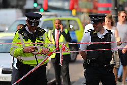 © Licensed to London News Pictures. 08/05/2018. London, UK.  The scene in Brixton where it is reported that an acid attack has taken place. Photo credit: Rob Pinney/LNP